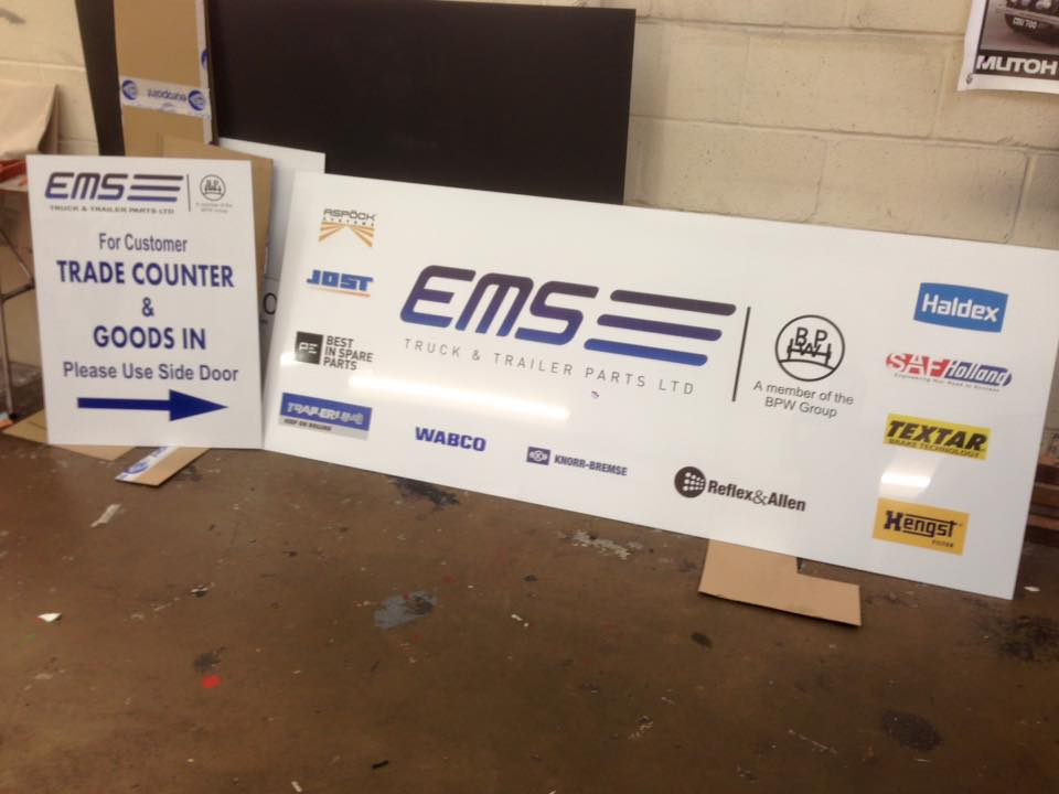 completely new business signs for ems truck parts company in northampton