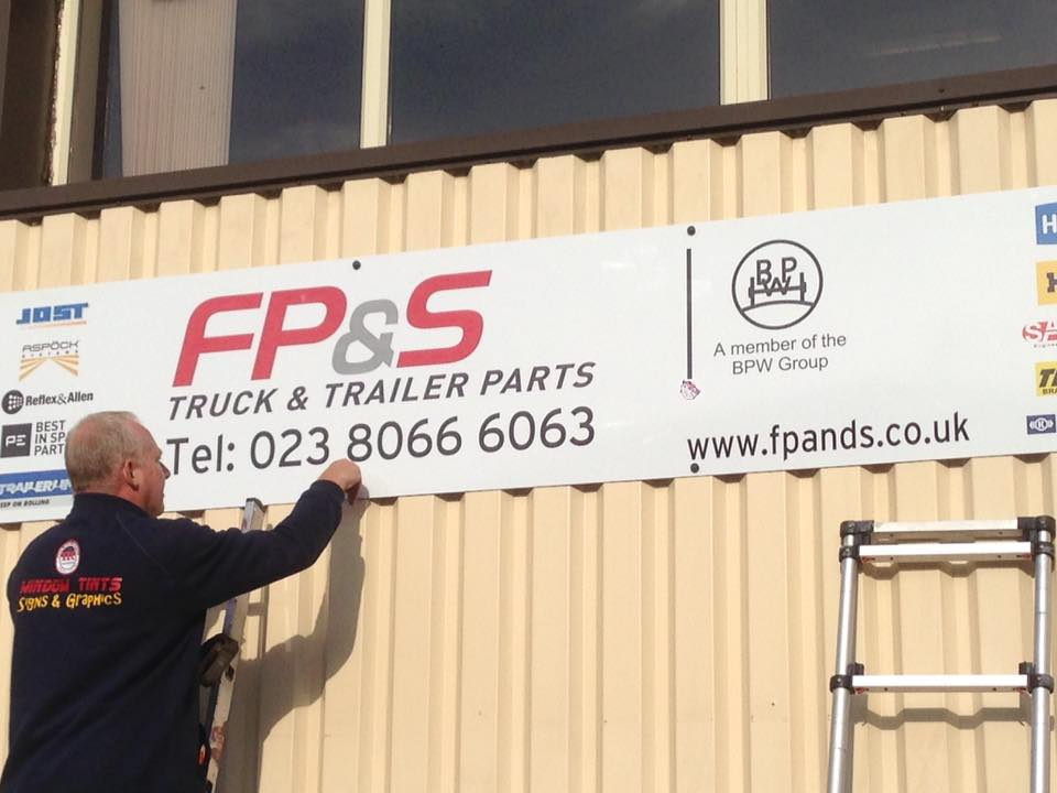 Shop Signs, commercial displays being fitted to a business in Northampton