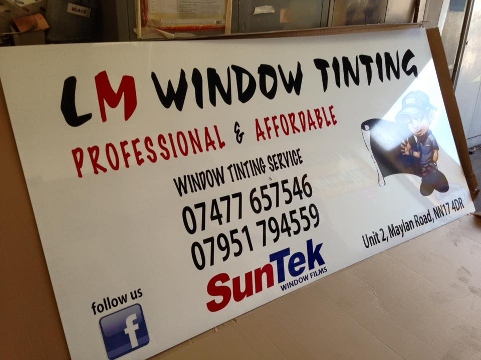a business sign for lm window tinting
